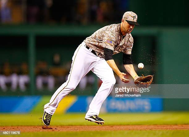 Jordy Mercer of the Pittsburgh Pirates bobbles a ground ball in the fifth inning against the St Louis Cardinals during the game at PNC Park on July 9...