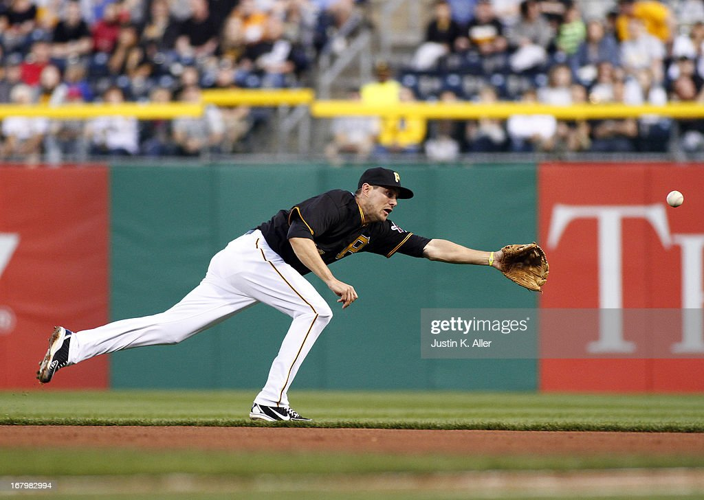 Jordy Mercer #10 of the Pittsburgh Pirates can't come up with a ground ball in the fourth inning against the Washington Nationals during the game on May 3, 2013 at PNC Park in Pittsburgh, Pennsylvania.