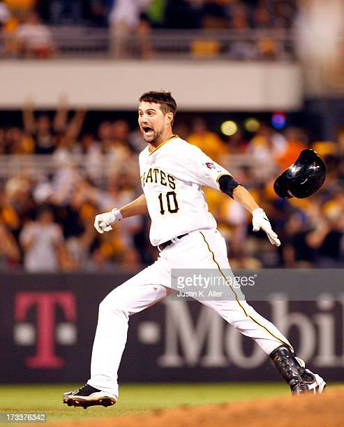 Jordy Mercer of the Pittsburgh Pirates celebrates after hitting the game winning RBI single in the eleventh inning against the New York Mets during...