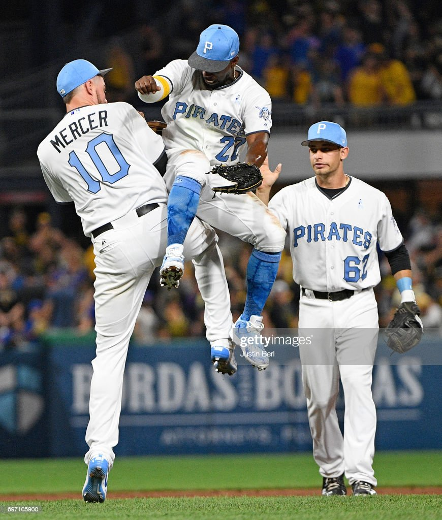 Jordy Mercer #10 of the Pittsburgh Pirates celebrates with Andrew McCutchen #22 after the final out in the Pittsburgh Pirates 4-3 win over the Chicago Cubs at PNC Park on June 17, 2017 in Pittsburgh, Pennsylvania.
