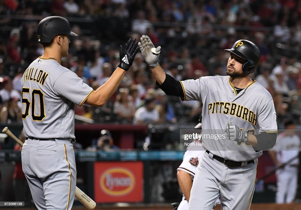 Jordy Mercer #10 of the Pittsburgh Pirates celebrates with teammate Jameson Taillon #50 after hitting a solo home run off of Zack Greinke of the Arizona Diamondbacks during the fouth inning at Chase Field on June 13, 2018 in Phoenix, Arizona.