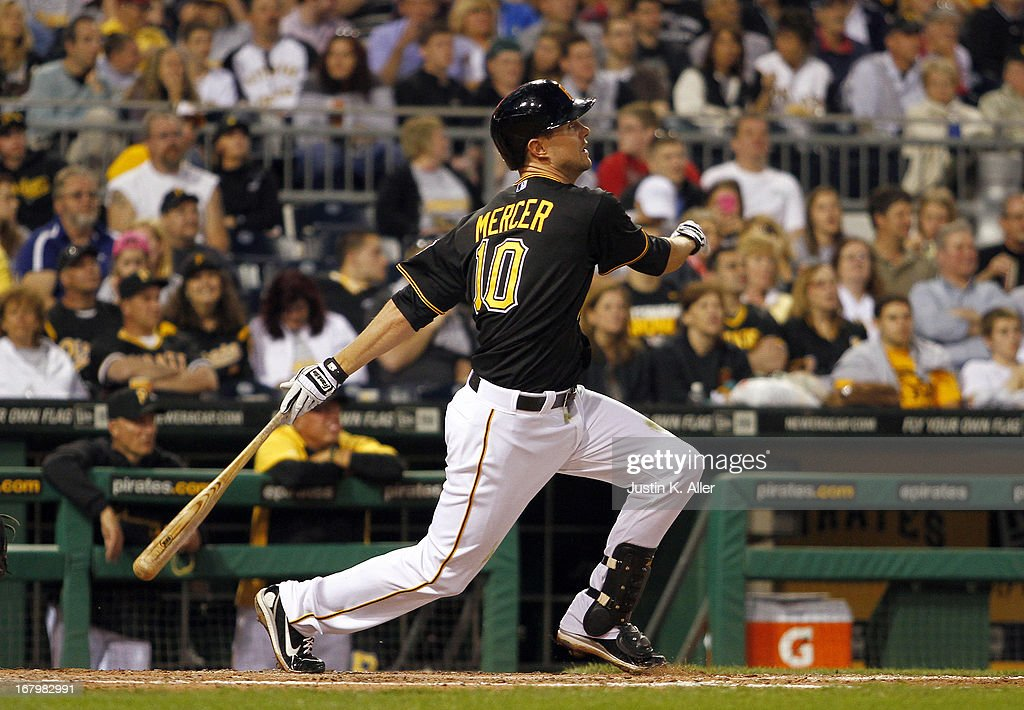 Jordy Mercer #10 of the Pittsburgh Pirates hits a two-run home run in the fifth inning against the Washington Nationals during the game on May 3, 2013 at PNC Park in Pittsburgh, Pennsylvania.