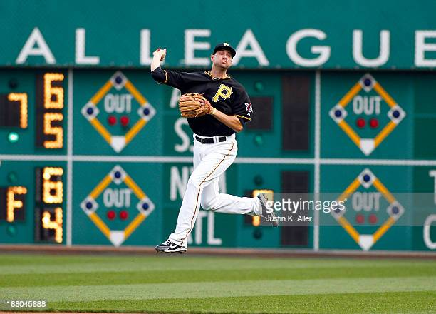 Jordy Mercer of the Pittsburgh Pirates makes a play on a ball deep in the hole against the Washington Nationals during the game on May 4 2013 at PNC...