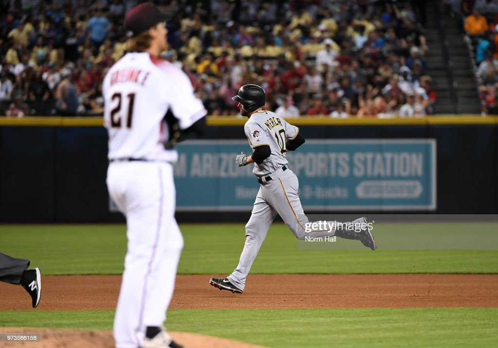 Jordy Mercer #10 of the Pittsburgh Pirates rounds the bases after hitting a solo home run off of Zack Greinke of the Arizona Diamondbacks during the fouth inning at Chase Field on June 13, 2018 in Phoenix, Arizona.