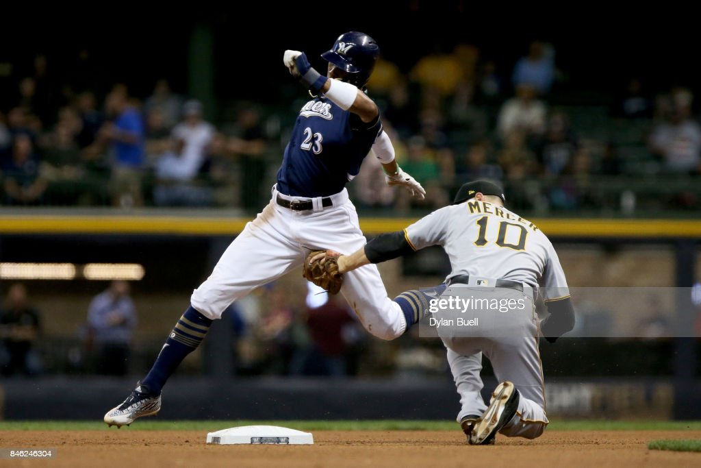 Jordy Mercer #10 of the Pittsburgh Pirates tags out Keon Broxton #23 of the Milwaukee Brewers during a steal attempt in the fourth inning at Miller Park on September 12, 2017 in Milwaukee, Wisconsin.