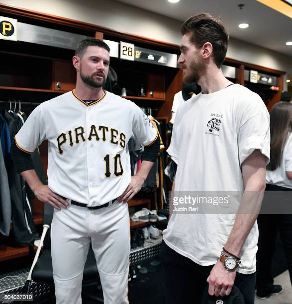 Jordy Mercer of the Pittsburgh Pirates talks to Matt Murray of the Pittsburgh Penguins before the game between the Pittsburgh Pirates and the...