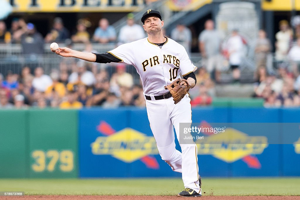 Jordy Mercer #10 of the Pittsburgh Pirates throws to first base to force out Peter Bourjos #17 of the Philadelphia Phillies in the fifth inning during the game at PNC Park on July 22, 2016 in Pittsburgh, Pennsylvania.