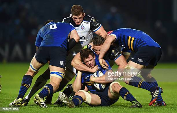 Jordy Murphy of Leinster is tackled by Max Lahiff of Bath during the European Champions cup Pool 5 rugby game at the RDS arena on January 16 2016 in...