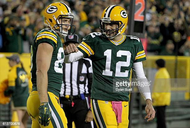 Jordy Nelson and Aaron Rodgers of the Green Bay Packers celebrate after scoring a touchdown in the first quarter against the New York Giants at...
