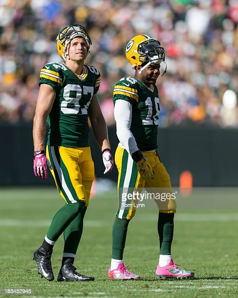 Jordy Nelson and Randall Cobb of the Green Bay Packers walk onto the field against the Detroit Lions at Lambeau Field on October 6, 2013 in Green...