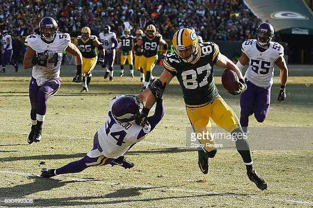 Jordy Nelson of the Green Bay Packers breaks a tackle by Andrew Sendejo of the Minnesota Vikings during the second quarter of a game at Lambeau Field...