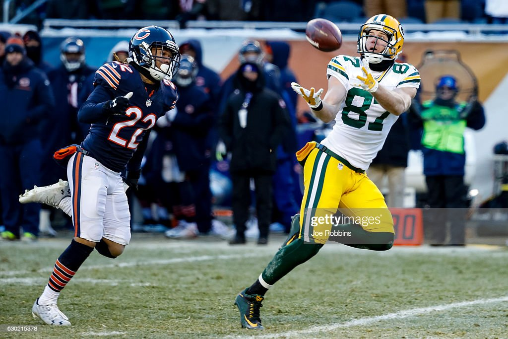 Jordy Nelson #87 of the Green Bay Packers completes the pass for 60 yds, ahead of Cre'von LeBlanc #22 of the Chicago Bears, in the fourth quarter at Soldier Field on December 18, 2016 in Chicago, Illinois. The Green Bay Packers defeated the Chicago Bears 30-27.