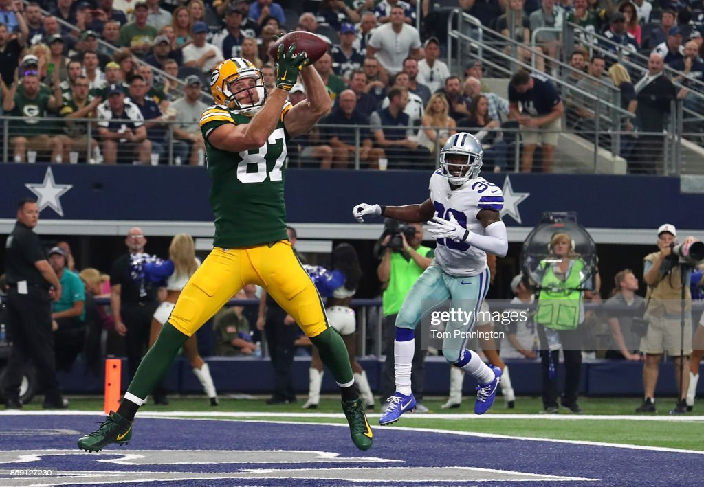 Jordy Nelson #87 of the Green Bay Packers goes up for a touchdown pass against the Dallas Cowboys in the third quarter of a football game at AT&T Stadium on October 8, 2017 in Arlington, Texas.