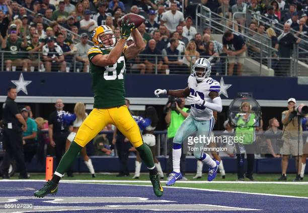 Jordy Nelson of the Green Bay Packers goes up for a touchdown pass against the Dallas Cowboys in the third quarter of a football game at ATT Stadium...