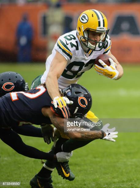 Jordy Nelson of the Green Bay Packers is tackled by Eddie Jackson and Cre'von LeBlanc of the Chicago Bears at Soldier Field on November 12 2017 in...