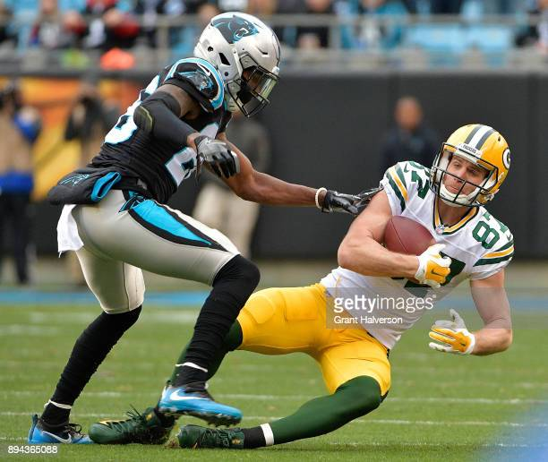 Jordy Nelson of the Green Bay Packers makes a catch against Daryl Worley of the Carolina Panthers during their game at Bank of America Stadium on...