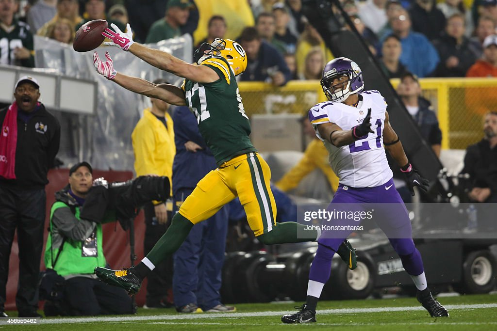 Jordy Nelson #87 of the Green Bay Packers reaches for a ball as Josh Robinson #21 of the Minnesota Vikings defends during the third quarter on October 02, 2014 at Lambeau Field in Green Bay, Wisconsin. Robinson was called for pass interference on the play and the Packers went on to defeat the Vikings 42-10.