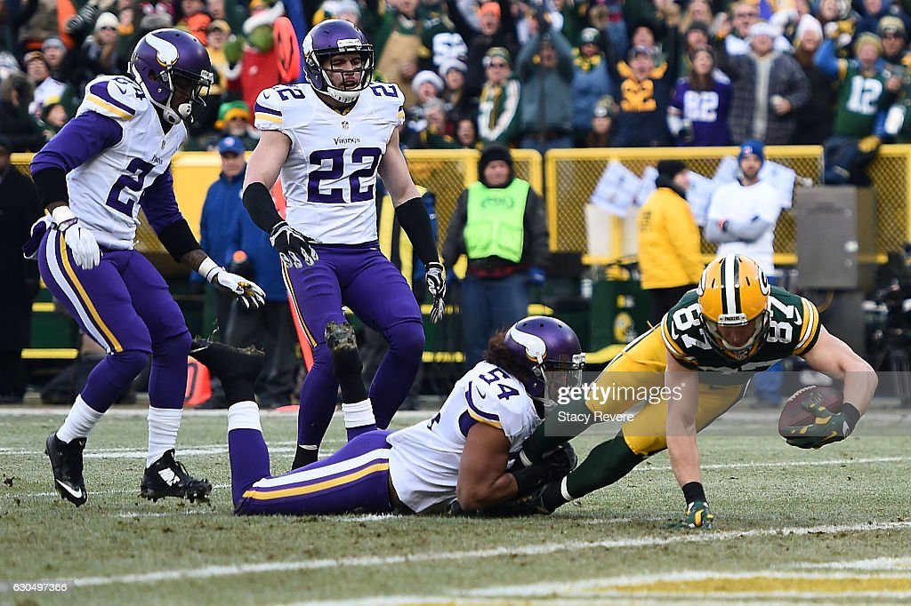 Jordy Nelson #87 of the Green Bay Packers scores a touchdown against Eric Kendricks #54 of the Minnesota Vikings during the first quarter of a game at Lambeau Field on December 24, 2016 in Green Bay, Wisconsin.
