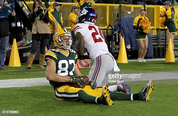 Jordy Nelson of the Green Bay Packers scores a touchdown past Eli Apple of the New York Giants in the first quarter at Lambeau Field on October 9...