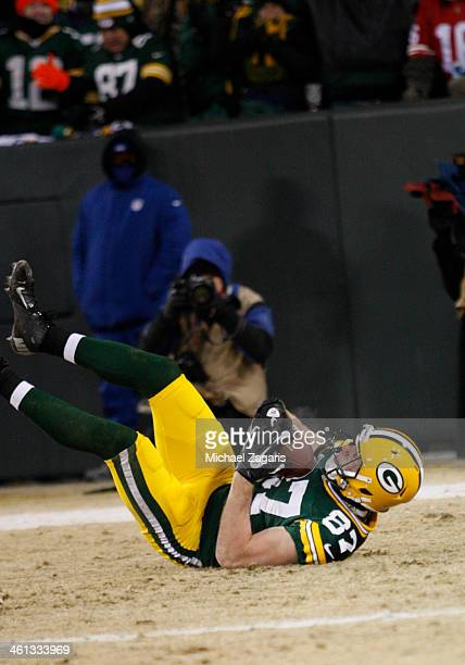 Jordy Nelson of the Green Bay Packers slides into the end zone on a 5yard touchdown reception during the game against the San Francisco 49ers at...
