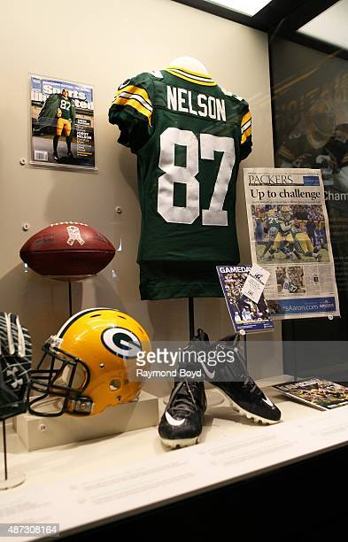 Jordy Nelson's December 28 2014 game worn jersey stands out amongst encased Green Bay Packers memorabilia inside the Green Bay Packers 'Hall Of Fame'...