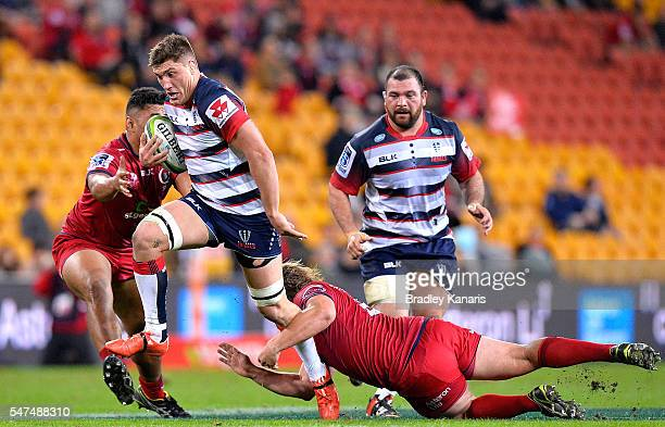 Jordy Reid of the Melbourne Rebels breaks through the defence during the round 17 Super Rugby match between the Reds and the Rebels at Suncorp...