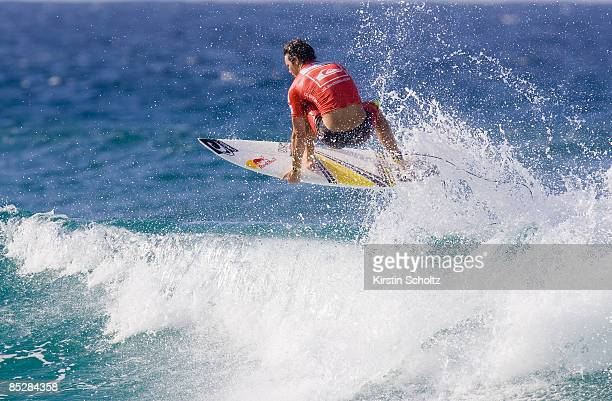 Jordy Smith of South Africa performs an aerial maneuver to win his round two heat against Dean Morrison of Australia during the Quiksilver Pro Gold...