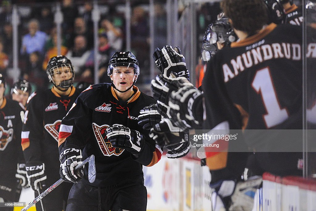 Jordy Stallard #17 of the Calgary Hitmen celebrates with the bench after scoring against the Prince Albert Raiders during a WHL game at Scotiabank Saddledome on December 3, 2015 in Calgary, Alberta, Canada.