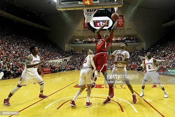 Jordy Tshimanga of the Nebraska Cornhuskers attempts a layup over Zach McRoberts of the Indiana Hoosiers in the first half at Assembly Hall on...