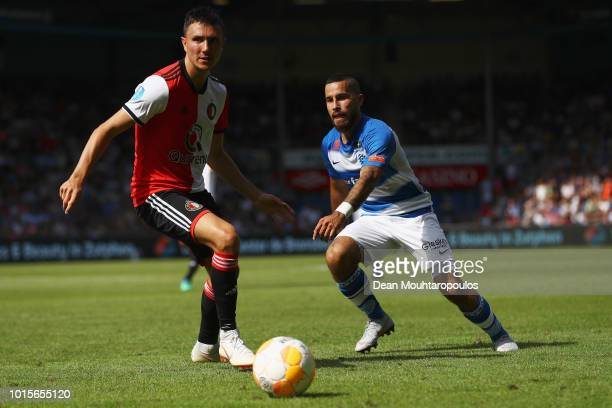 Jordy Tutuarima of De Graafschap battles for the ball with Steven Berghuis of Feyenoord during the Eredivisie match between De Graafschap and...