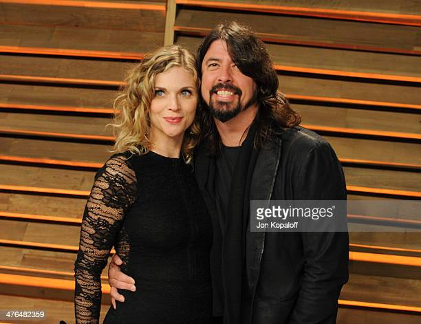 Jordyn Blum and Dave Grohl attend the 2014 Vanity Fair Oscar Party hosted by Graydon Carter on March 2 2014 in West Hollywood California