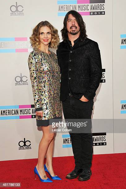 Jordyn Blum and recording artist Dave Grohl attend the 2013 American Music Awards at Nokia Theatre LA Live on November 24 2013 in Los Angeles...