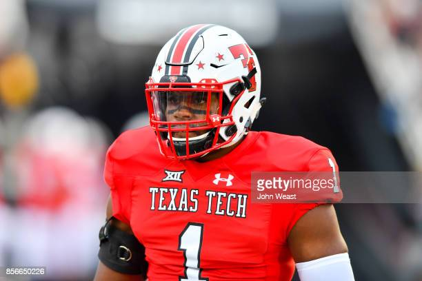 Jordyn Brooks of the Texas Tech Red Raiders on the field during warmups before the game between the Texas Tech Red Raiders and the Oklahoma State...