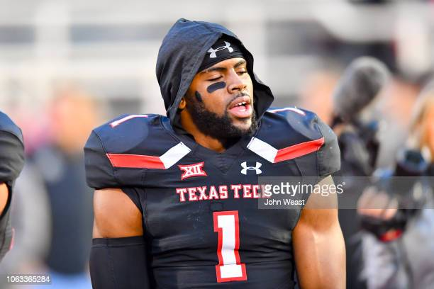 Jordyn Brooks of the Texas Tech Red Raiders stands on the field before the game against the Oklahoma Sooners on November 3 2018 at Jones ATT Stadium...