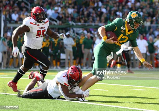 Jordyn Brooks of the Texas Tech Red Raiders tackles Charlie Brewer of the Baylor Bears in the first half on October 12 2019 in Waco Texas