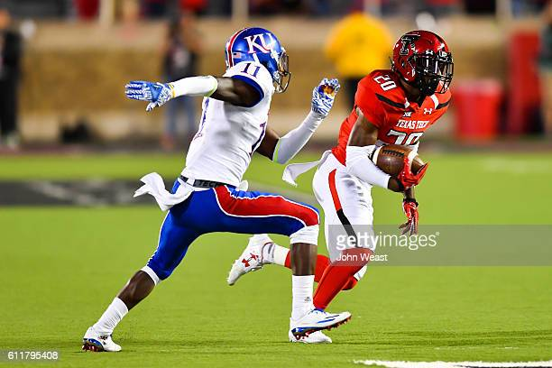 Jordyn Brooks of the Texas Tech Red Raiders tries to run past Mike Lee of the Kansas Jayhawks during the game on September 29 2016 at ATT Jones...