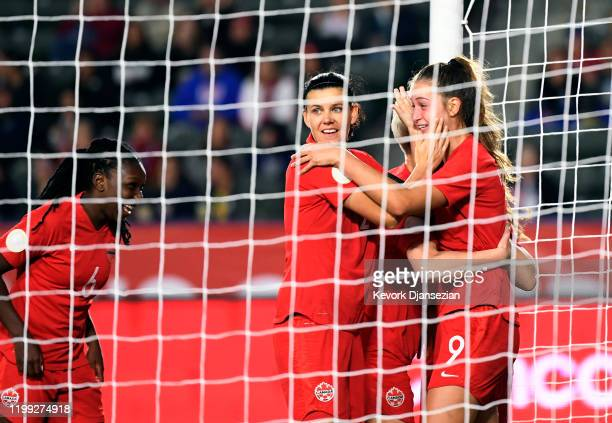 Jordyn Huitema of Canada celebrates her goal with Christine Sinclair and Deanne Rose against Costa Rica during the second half of the Semifinals 2020...