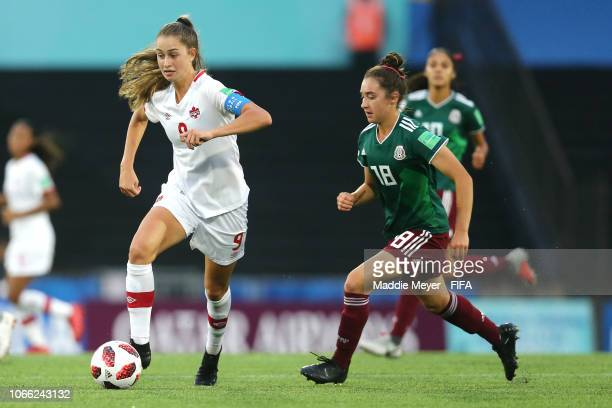 Jordyn Huitema of Canada dribbles past Silvana Flores of Mexico during the FIFA U17 Women's World Cup Uruguay 2018 semifinal match between Mexico and...