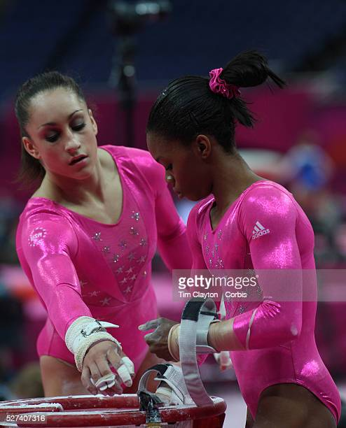 Jordyn Wieber and Gabrielle Douglas USA prepare for the uneven bars during the Women's Artistic Gymnastics podium training at North Greenwich Arena...