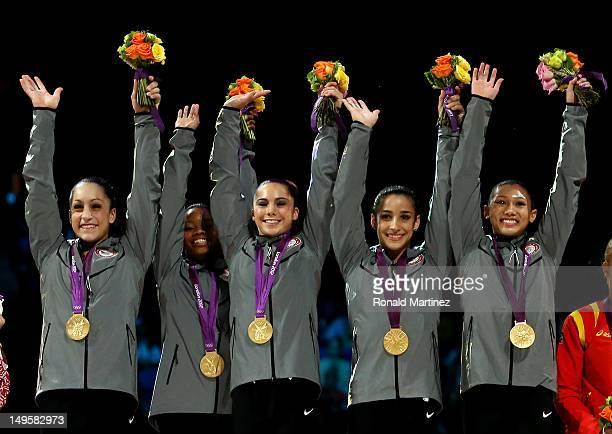 Jordyn Wieber Gabrielle Douglas Mc Kayla Maroney Alexandra Raisman and Kyla Ross of the United States celebrate on the podium after winning the gold...