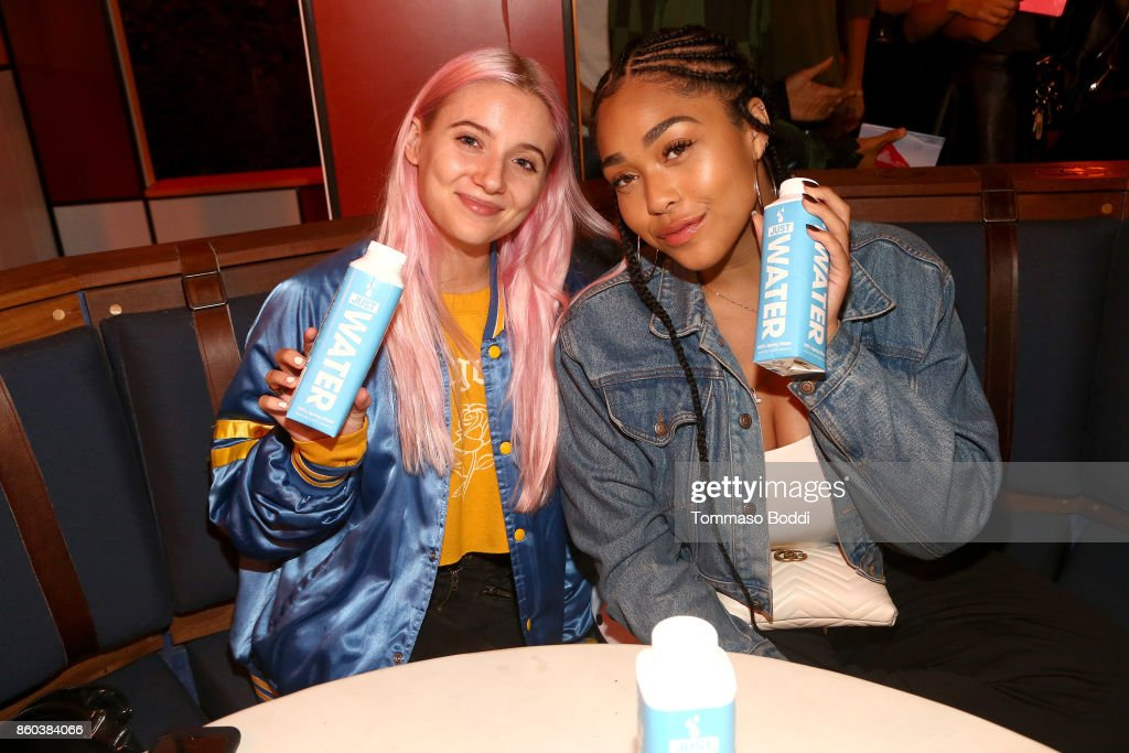 Jordyn Woods (R) and guest attend the Umami Burger x Jaden Smith Artist Series Launch Event at The Grove on October 11, 2017 in Los Angeles, California.