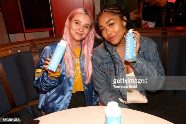 Jordyn Woods and guest attend the Umami Burger x Jaden Smith Artist Series Launch Event at The Grove on October 11 2017 in Los Angeles California