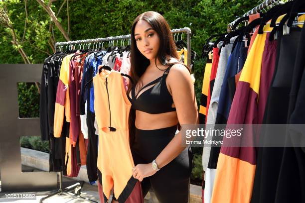 Jordyn Woods attends the launch event of the activewear label SECNDNTURE by Jordyn Woods at a private residence on August 29, 2018 in West Hollywood,...