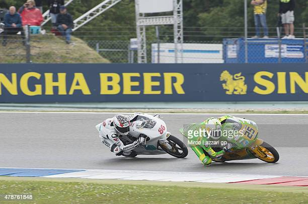 Jorel Boerboom of Netherland and FPW Racing leads Kevin Hanus of Netherland and Team Hanusch during the Moto3 race during the MotoGP Netherlands Race...