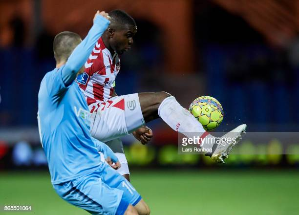 Jores Okore of AaB Aalborg and Marvin Pourie of Randers FC compete for the ball during the Danish Alka Superliga match between Randers FC and AaB...