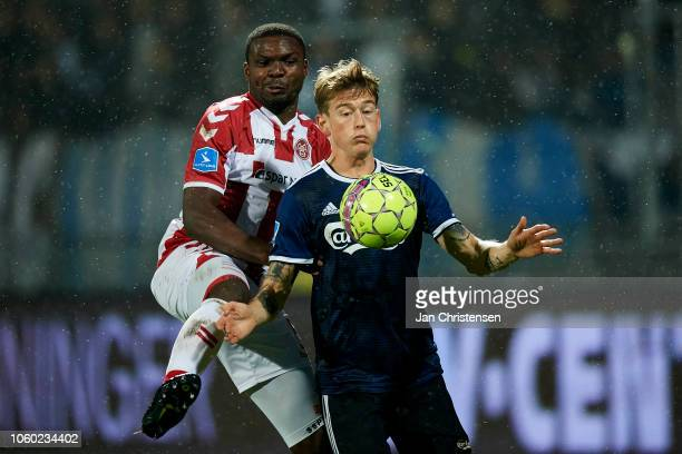 Jores Okore of AaB Aalborg and Nicolaj Thomsen of FC Copenhagen compete for the ball during the Danish Superliga match between AaB Aalborg and FC...