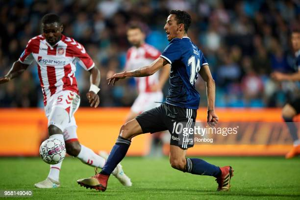 Jores Okore of AaB Aalborg and Zeca of FC Copenhagen compete for the ball during the Danish Alka Superliga match between AaB Aalborg and FC...
