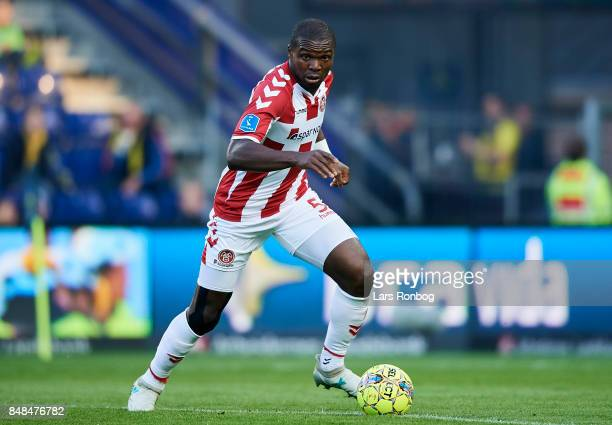 Jores Okore of AaB Aalborg controls the ball during the Danish Alka Superliga match between Brondby IF and AaB Aalborg at Brondby Stadion on...