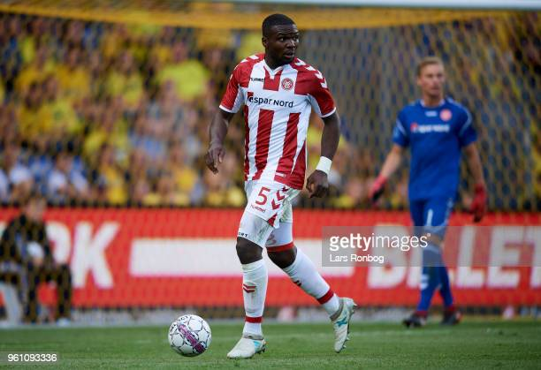 Jores Okore of AaB Aalborg controls the ball during the Danish Alka Superliga match between Brondby IF and AaB Aalborg at Brondby Stadion on May 21...