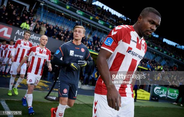 Jores Okore of AaB Aalborg leading his on to the pitch prior to the Danish Superliga match between Brondby IF and AaB Aalborg at Brondby Stadion on...
